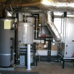 This system uses a Ground Source (Geothermal) Heat Pump for forced air heating and cooling, as well as heating water for radiant floor heat. It also heats the domestic hot water.